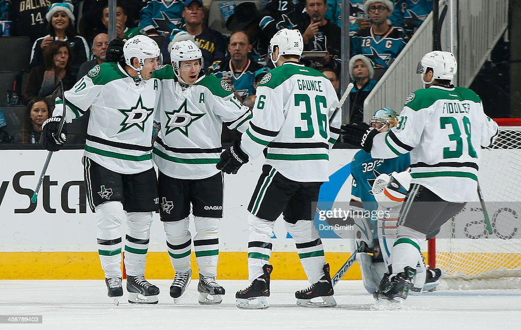 Shawn Horcoff #10, Ray Whitney #13, Cameron Gaunce #36 and Vernon Fiddler #38 of the Dallas Stars celebrate a goal against the San Jose Sharks during an NHL game on December 21, 2013 at SAP Center in San Jose, California.