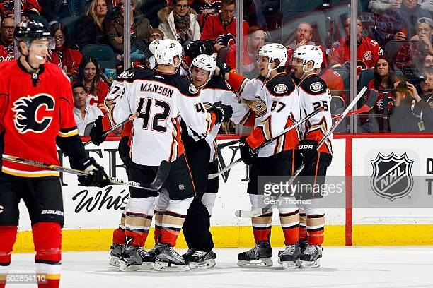 Shawn Horcoff Rickard Rackell and teammates of the Anaheim Ducks celebrate a goal against the Calgary Flames during an NHL game at Scotiabank...