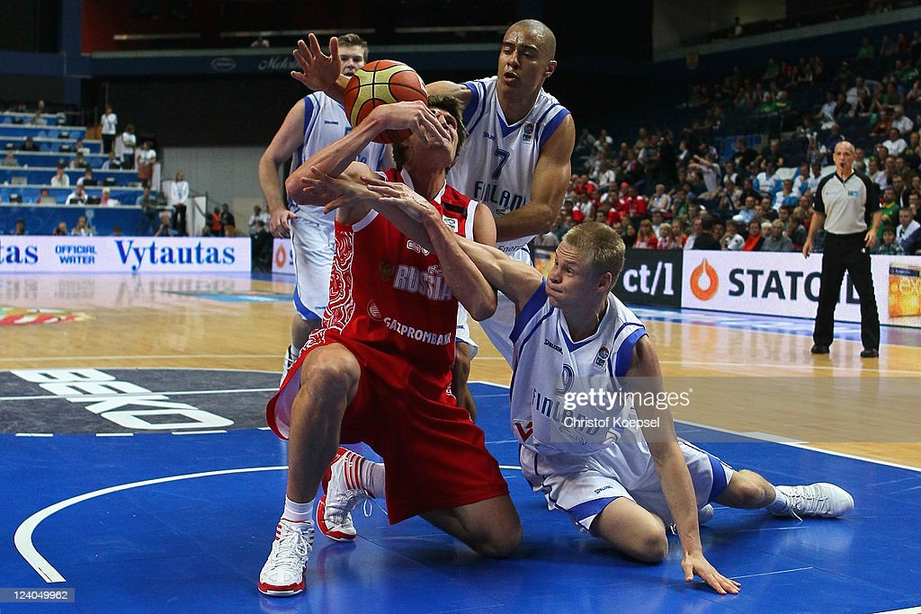 Shawn Huff of Finland (C) and Sasu Salin of Finland (R) defend against <a gi-track='captionPersonalityLinkClicked' href=/galleries/search?phrase=Andrei+Kirilenko&family=editorial&specificpeople=201909 ng-click='$event.stopPropagation()'>Andrei Kirilenko</a> of Russia during the EuroBasket 2011 second round group B match between Finland and Russia at Siemens Arena on September 8, 2011 in Vilnius, Lithuania.