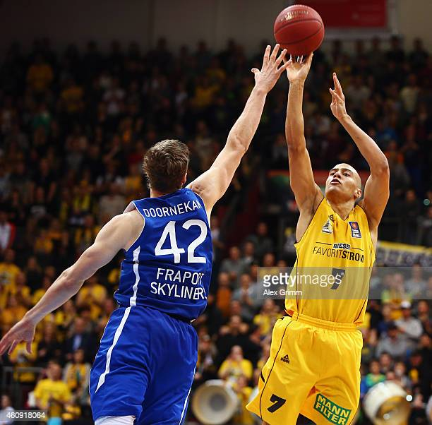 Shawn Huff of Ludwigsburg is challenged by Aaron Doornekamp of Frankfurt during the Beko BBL basketball match between MHP Riesen Ludwigsburg and...