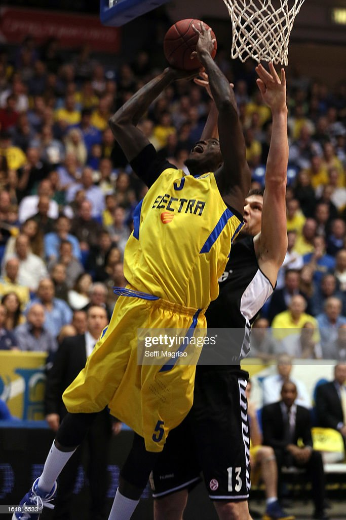 Shawn James, #5 of Maccabi Electra Tel Aviv competes with Gasper Vidmar, 13# of Besiktas JK Istanbul in action during the 2012-2013 Turkish Airlines Euroleague Top 16 Date 13 between Maccabi Electra Tel Aviv v Besiktas JK Istanbul at Nokia Arena on March 28, 2013 in Tel Aviv, Israel.