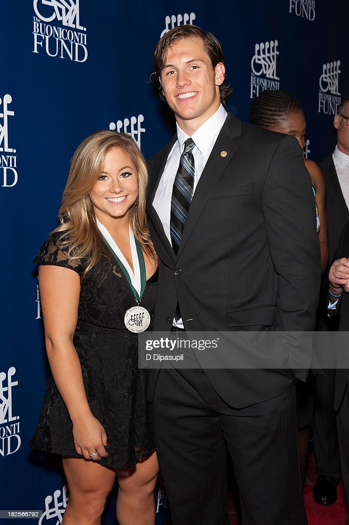 Shawn Johnson (L) and Andrew East attend the 28th Annual Great Sports Legends Dinner to Benefit The Buoniconti Fund To Cure Paralysis at The Waldorf=Astoria on September 30, 2013 in New York City.