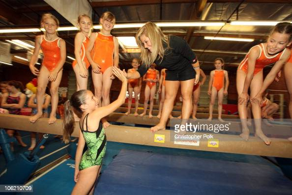 Shawn Johnson makes a surprise visit and highfives Crystal Gonzales age 9 of Burbank CA at the Golden State Gym in Burbank CA on May 13 2009 EShawn...
