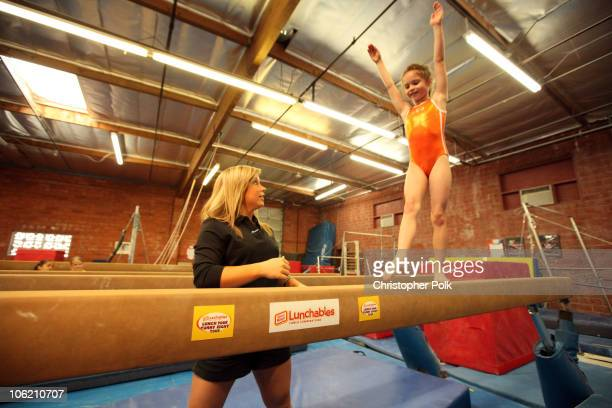 Shawn Johnson makes a surprise visit and offers coaching tips to Destiny Whitlock age 8 of Burbank CA at the Golden State Gym in Burbank CA on May 13...