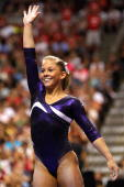 Shawn Johnson reacts after competing on the balance beam during day four of the 2008 US Olympic Team Trials for gymnastics at the Wachovia Center on...