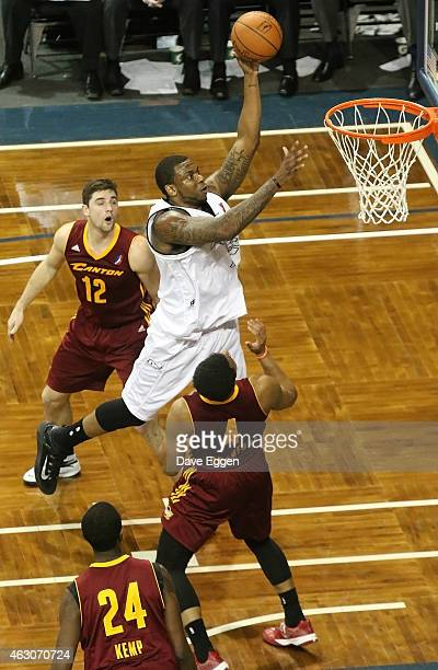 Shawn Jones from the Sioux Falls Skyforce takes the ball to the basket past Joe Harris Chris Crawford and Maurice Kemp from the Canton Charge in the...