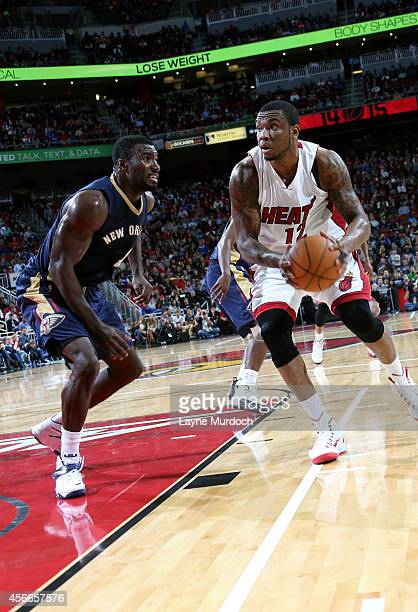 Shawn Jones of the Miami Heat drives against Patric Young of the New Orleans Pelicans during an NBA game on October 4 2014 at the KFC Yum Center in...