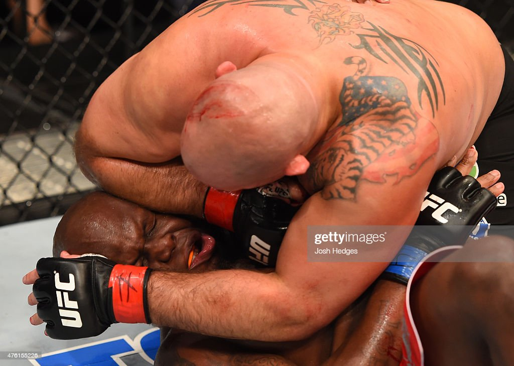 Shawn Jordan elbows Derrick Lewis in their heavyweight bout during the UFC event at the Smoothie King Center on June 6 2015 in New Orleans Louisiana