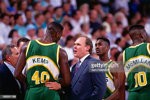Shawn Kemp and head coach of the Seattle Supersonics George Karl talk against the Golden State Warriors circa 1994 at the OaklandAlameda County...