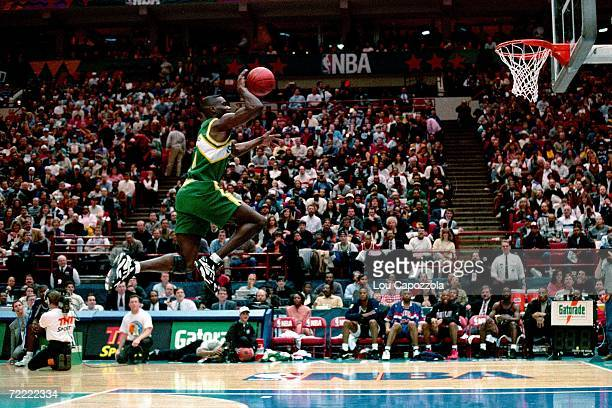 Shawn Kemp fot the Seattle Supersonics attempts a dunk from the foul line during the 1994 Slam Dunk Contest on February 12 1994 at the Target Center...