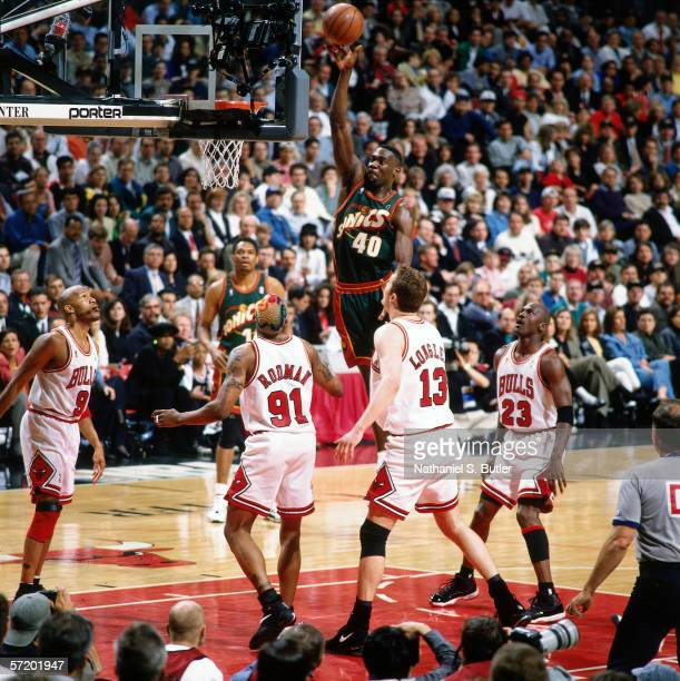 Shawn Kemp of the Seattle Supersonics goes for a dunk against the Chicago Bulls during game two of the 1996 NBA Finals circa 1996 at Chicago Stadium...