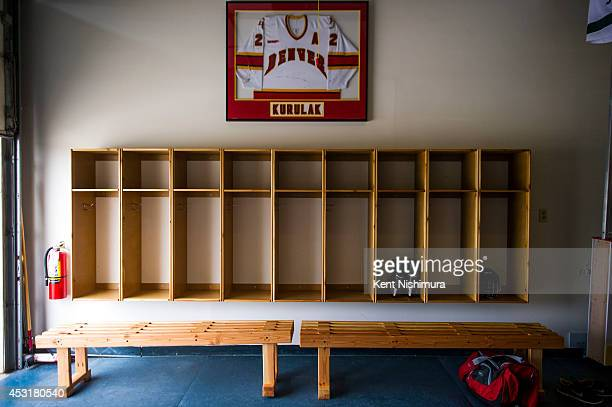 Shawn Kurulak's Denver University jersey is seen hanging above a bench area at Bar Down Shooting on Tuesday July 08 2014 in Broomfield CO Bar Down...