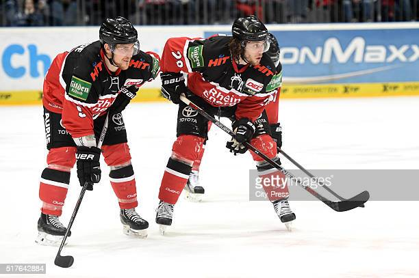 Shawn Lalonde and Ryan Jones of the Koelner Haien during the DEL playoff match between Koelner Haie and the Eisbaeren Berlin on March 26 2016 in...