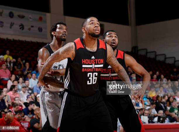 Shawn Long of the Houston Rockets boxes out the Atlanta Hawks during the 2017 Summer League on July 14 2017 at Cox Pavillion in Las Vegas Nevada NOTE...
