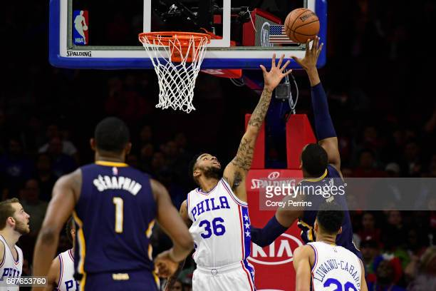 Shawn Long of the Philadelphia 76ers defends against Lavoy Allen of the Indiana Pacers during the second quarter at the Wells Fargo Center on April...