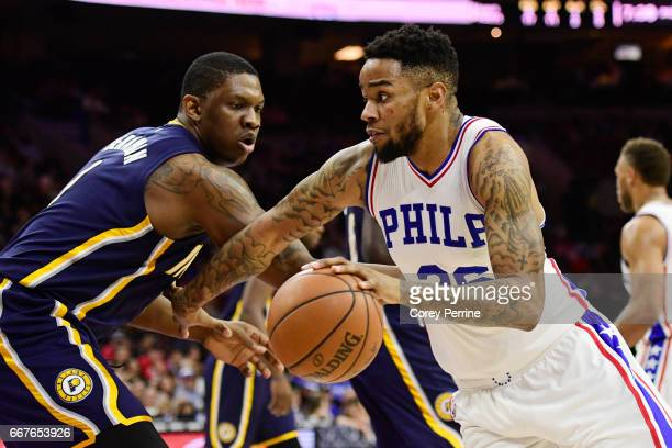Shawn Long of the Philadelphia 76ers drives against Kevin Seraphin of the Indiana Pacers during the second quarter at the Wells Fargo Center on April...