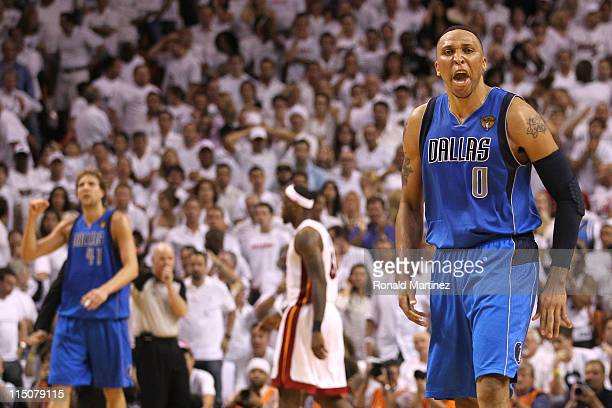 Shawn Marion and Dirk Nowitzki of the Dallas Mavericks celebrate as LeBron James of the Miami Heat walks towards the bench in Game Two of the 2011...