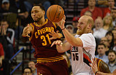 Shawn Marion of the Cleveland Cavaliers and Chris Kaman of the Portland Trail Blazers battle for a ball during the fourth quarter of the game at Moda...