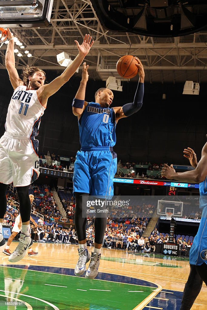 <a gi-track='captionPersonalityLinkClicked' href=/galleries/search?phrase=Shawn+Marion&family=editorial&specificpeople=201566 ng-click='$event.stopPropagation()'>Shawn Marion</a> #0 of the Dallas Mavericks brings down the rebound against <a gi-track='captionPersonalityLinkClicked' href=/galleries/search?phrase=Josh+McRoberts&family=editorial&specificpeople=732530 ng-click='$event.stopPropagation()'>Josh McRoberts</a> #11 of the Charlotte Bobcats at the Greensboro Coliseum on October 19, 2013 in Greensboro, North Carolina.