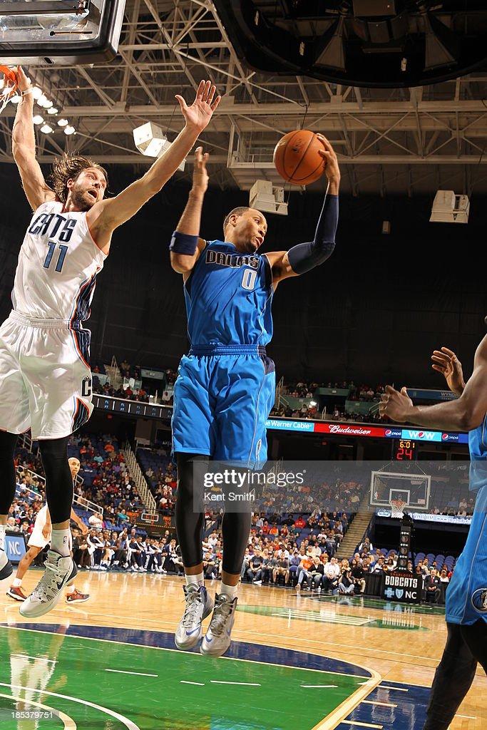 Shawn Marion #0 of the Dallas Mavericks brings down the rebound against Josh McRoberts #11 of the Charlotte Bobcats at the Greensboro Coliseum on October 19, 2013 in Greensboro, North Carolina.