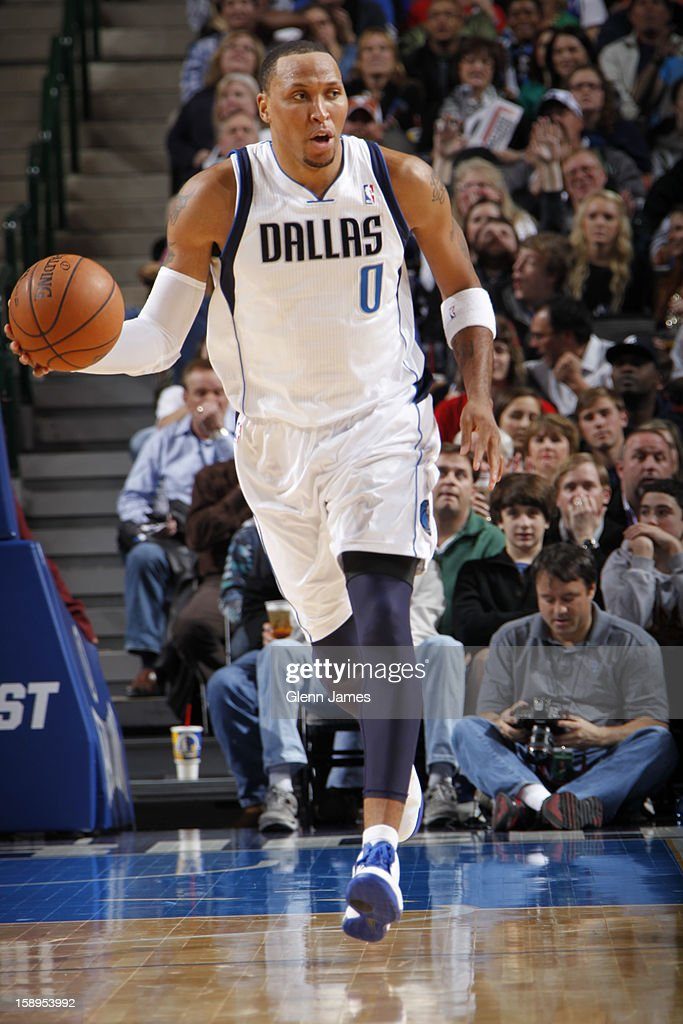 <a gi-track='captionPersonalityLinkClicked' href=/galleries/search?phrase=Shawn+Marion&family=editorial&specificpeople=201566 ng-click='$event.stopPropagation()'>Shawn Marion</a> #0 of the Dallas Mavericks brings the ball up court against the Denver Nuggets on December 28, 2012 at the American Airlines Center in Dallas, Texas.