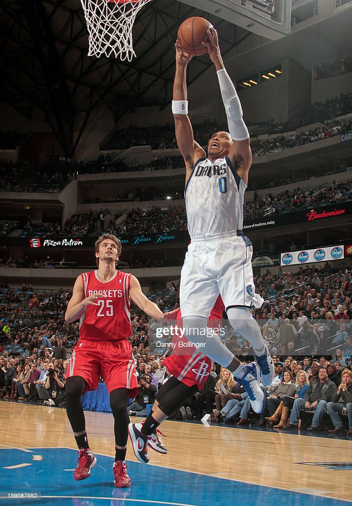 Shawn Marion #0 of the Dallas Mavericks dunks against Chandler Parsons #25 of the Houston Rockets on January 16, 2013 at the American Airlines Center in Dallas, Texas.