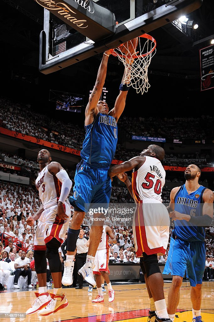 <a gi-track='captionPersonalityLinkClicked' href=/galleries/search?phrase=Shawn+Marion&family=editorial&specificpeople=201566 ng-click='$event.stopPropagation()'>Shawn Marion</a> #0 of the Dallas Mavericks dunks against <a gi-track='captionPersonalityLinkClicked' href=/galleries/search?phrase=Joel+Anthony&family=editorial&specificpeople=4092295 ng-click='$event.stopPropagation()'>Joel Anthony</a> #50 of the Miami Heat during Game One of the 2011 NBA Finals on May 31, 2011 at the American Airlines Arena in Miami, Florida.