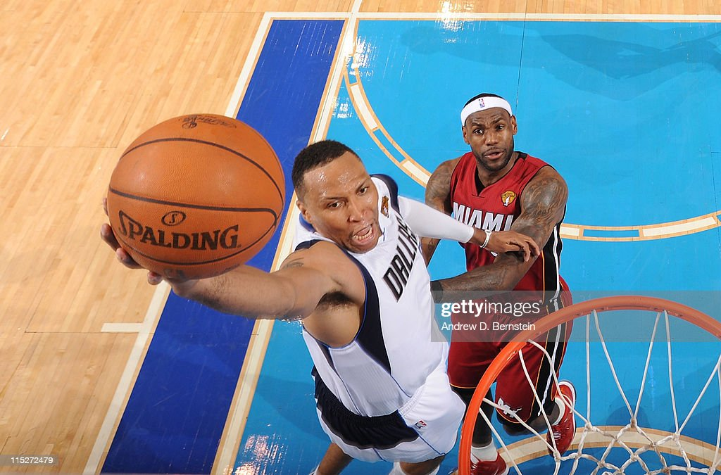 <a gi-track='captionPersonalityLinkClicked' href=/galleries/search?phrase=Shawn+Marion&family=editorial&specificpeople=201566 ng-click='$event.stopPropagation()'>Shawn Marion</a> #0 of the Dallas Mavericks dunks against <a gi-track='captionPersonalityLinkClicked' href=/galleries/search?phrase=LeBron+James&family=editorial&specificpeople=201474 ng-click='$event.stopPropagation()'>LeBron James</a> #6 of the Miami Heat during Game Three of the 2011 NBA Finals against the on June 5, 2011 at the American Airlines Center in Dallas, Texas.