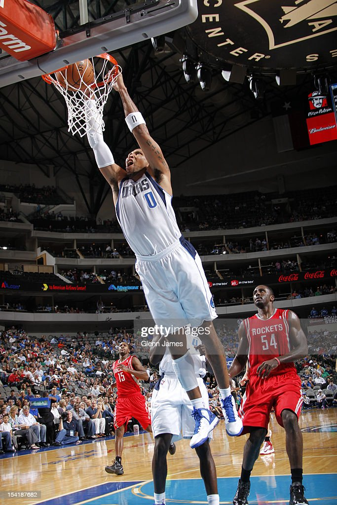 <a gi-track='captionPersonalityLinkClicked' href=/galleries/search?phrase=Shawn+Marion&family=editorial&specificpeople=201566 ng-click='$event.stopPropagation()'>Shawn Marion</a> #0 of the Dallas Mavericks dunks against <a gi-track='captionPersonalityLinkClicked' href=/galleries/search?phrase=Patrick+Patterson&family=editorial&specificpeople=2928099 ng-click='$event.stopPropagation()'>Patrick Patterson</a> #54 of the Houston Rockets on October 15, 2012 at the American Airlines Center in Dallas, Texas.