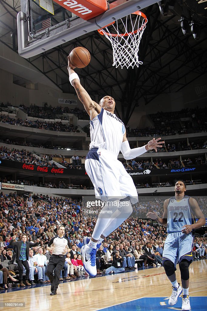 <a gi-track='captionPersonalityLinkClicked' href=/galleries/search?phrase=Shawn+Marion&family=editorial&specificpeople=201566 ng-click='$event.stopPropagation()'>Shawn Marion</a> #0 of the Dallas Mavericks dunks against <a gi-track='captionPersonalityLinkClicked' href=/galleries/search?phrase=Rudy+Gay&family=editorial&specificpeople=236066 ng-click='$event.stopPropagation()'>Rudy Gay</a> #22 of the Memphis Grizzlies on January 12, 2013 at the American Airlines Center in Dallas, Texas.