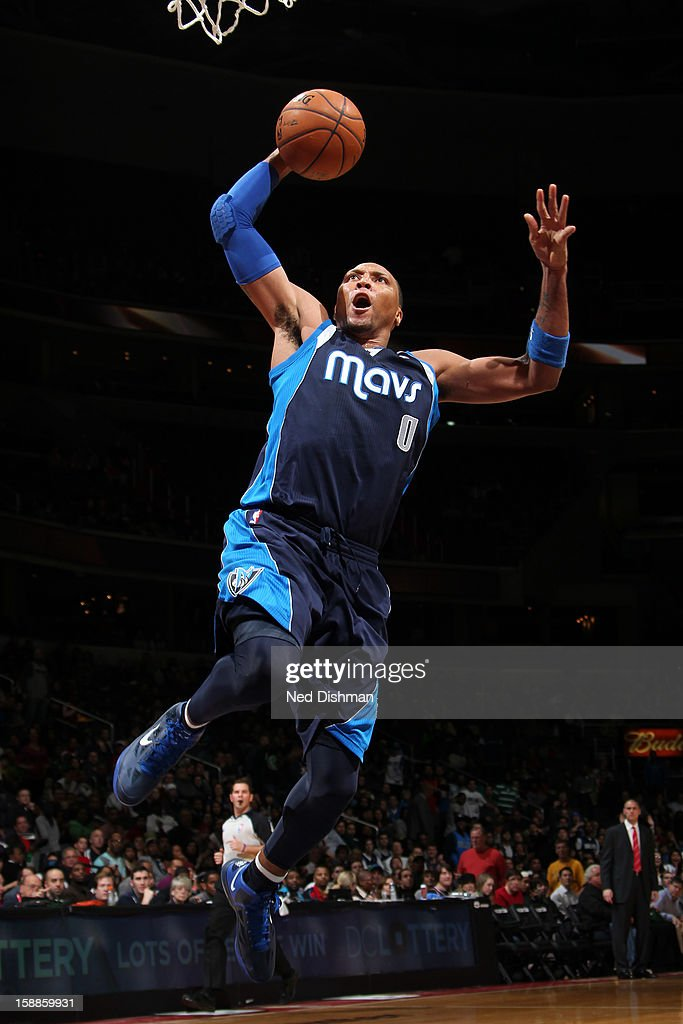 <a gi-track='captionPersonalityLinkClicked' href=/galleries/search?phrase=Shawn+Marion&family=editorial&specificpeople=201566 ng-click='$event.stopPropagation()'>Shawn Marion</a> #0 of the Dallas Mavericks dunks against the Washington Wizards during the game at the Verizon Center on January 1, 2013 in Washington, DC.