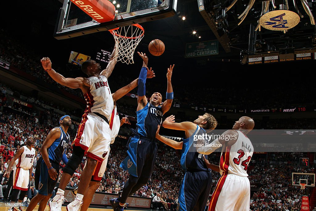 <a gi-track='captionPersonalityLinkClicked' href=/galleries/search?phrase=Shawn+Marion&family=editorial&specificpeople=201566 ng-click='$event.stopPropagation()'>Shawn Marion</a> #0 of the Dallas Mavericks fights for position against the Miami Heat on January 2, 2013 at American Airlines Arena in Miami, Florida.