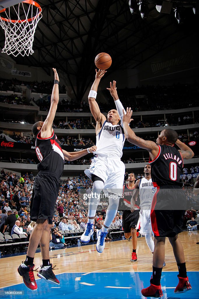 Shawn Marion #0 of the Dallas Mavericks goes in for the floater against Nicolas Batum #88 and Damian Lillard #0 of the Portland Trail Blazers on February 6, 2013 at the American Airlines Center in Dallas, Texas.