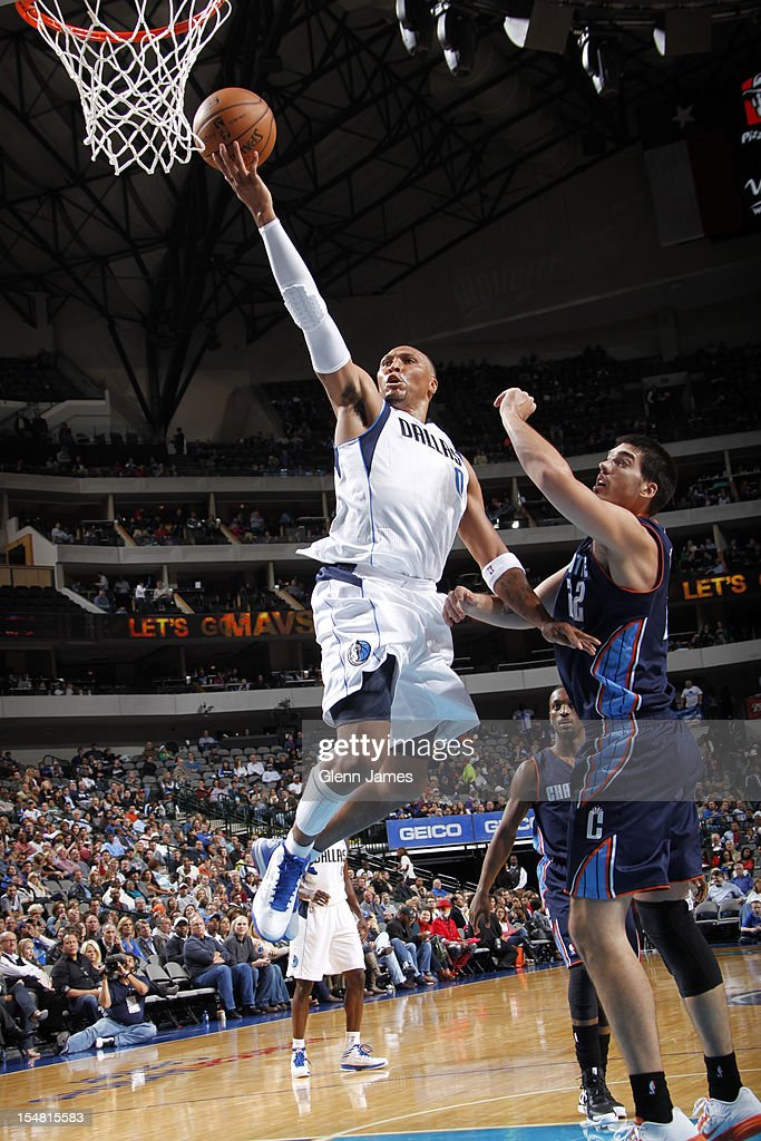 <a gi-track='captionPersonalityLinkClicked' href=/galleries/search?phrase=Shawn+Marion&family=editorial&specificpeople=201566 ng-click='$event.stopPropagation()'>Shawn Marion</a> #0 of the Dallas Mavericks goes in for the layup against Byron Mullens #22 of the Charlotte Bobcats on October 26, 2012 at the American Airlines Center in Dallas, Texas.