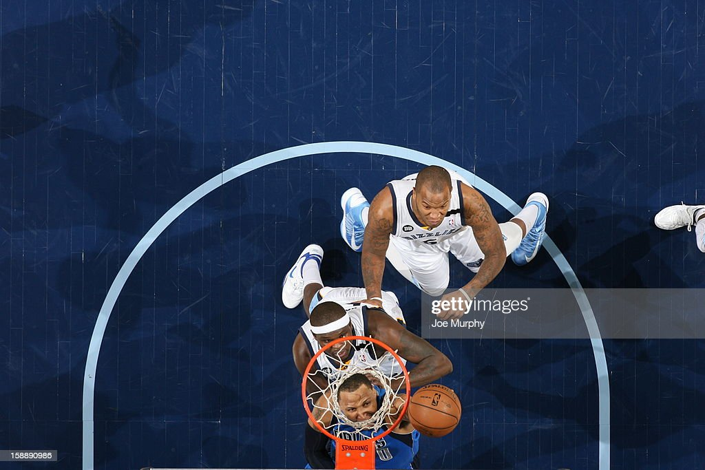 <a gi-track='captionPersonalityLinkClicked' href=/galleries/search?phrase=Shawn+Marion&family=editorial&specificpeople=201566 ng-click='$event.stopPropagation()'>Shawn Marion</a> #0 of the Dallas Mavericks goes to the basket against <a gi-track='captionPersonalityLinkClicked' href=/galleries/search?phrase=Zach+Randolph&family=editorial&specificpeople=201595 ng-click='$event.stopPropagation()'>Zach Randolph</a> #50 and <a gi-track='captionPersonalityLinkClicked' href=/galleries/search?phrase=Marreese+Speights&family=editorial&specificpeople=4187263 ng-click='$event.stopPropagation()'>Marreese Speights</a> #5 of the Memphis Grizzlies on December 21, 2012 at FedExForum in Memphis, Tennessee.