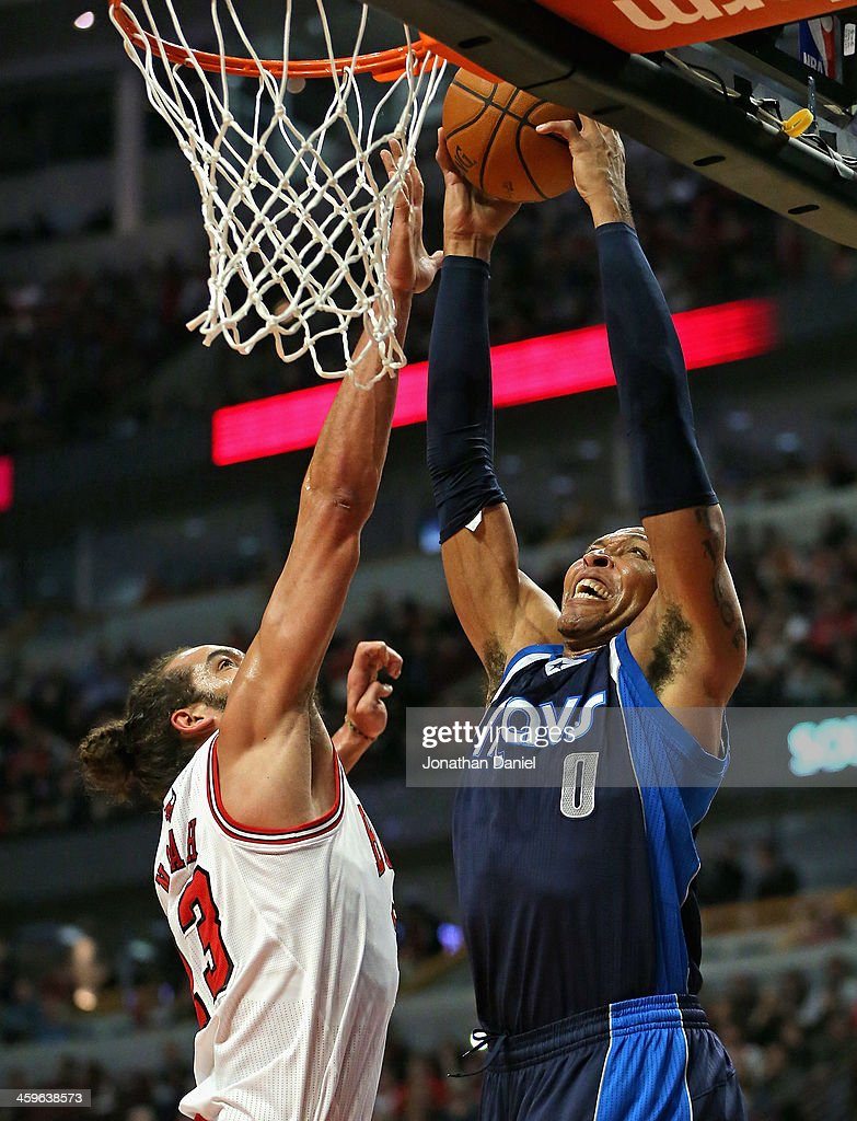 Shawn Marion #0 of the Dallas Mavericks goes up for a dunk over Joakim Noah #13 of the Chicago Bulls at the United Center on December 28, 2013 in Chicago, Illinois.