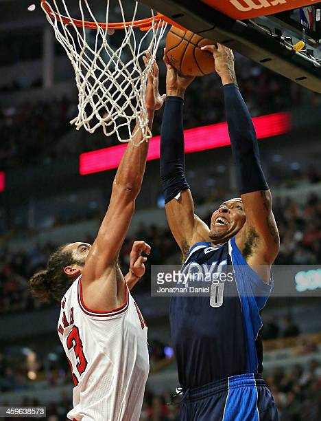 Shawn Marion of the Dallas Mavericks goes up for a dunk over Joakim Noah of the Chicago Bulls at the United Center on December 28 2013 in Chicago...