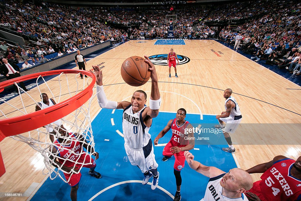 <a gi-track='captionPersonalityLinkClicked' href=/galleries/search?phrase=Shawn+Marion&family=editorial&specificpeople=201566 ng-click='$event.stopPropagation()'>Shawn Marion</a> #0 of the Dallas Mavericks grabs a rebound against <a gi-track='captionPersonalityLinkClicked' href=/galleries/search?phrase=Thaddeus+Young&family=editorial&specificpeople=3847270 ng-click='$event.stopPropagation()'>Thaddeus Young</a> #21 of the Philadelphia 76ers on December 18, 2012 at the American Airlines Center in Dallas, Texas.