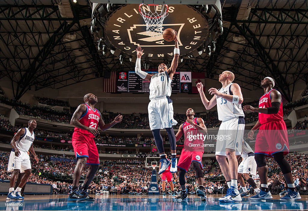 <a gi-track='captionPersonalityLinkClicked' href=/galleries/search?phrase=Shawn+Marion&family=editorial&specificpeople=201566 ng-click='$event.stopPropagation()'>Shawn Marion</a> #0 of the Dallas Mavericks grabs a rebound against <a gi-track='captionPersonalityLinkClicked' href=/galleries/search?phrase=Thaddeus+Young&family=editorial&specificpeople=3847270 ng-click='$event.stopPropagation()'>Thaddeus Young</a> #21 and <a gi-track='captionPersonalityLinkClicked' href=/galleries/search?phrase=Jason+Richardson+-+Basketball+Player+-+Born+1981&family=editorial&specificpeople=201558 ng-click='$event.stopPropagation()'>Jason Richardson</a> #23 of the Philadelphia 76ers on December 18, 2012 at the American Airlines Center in Dallas, Texas.