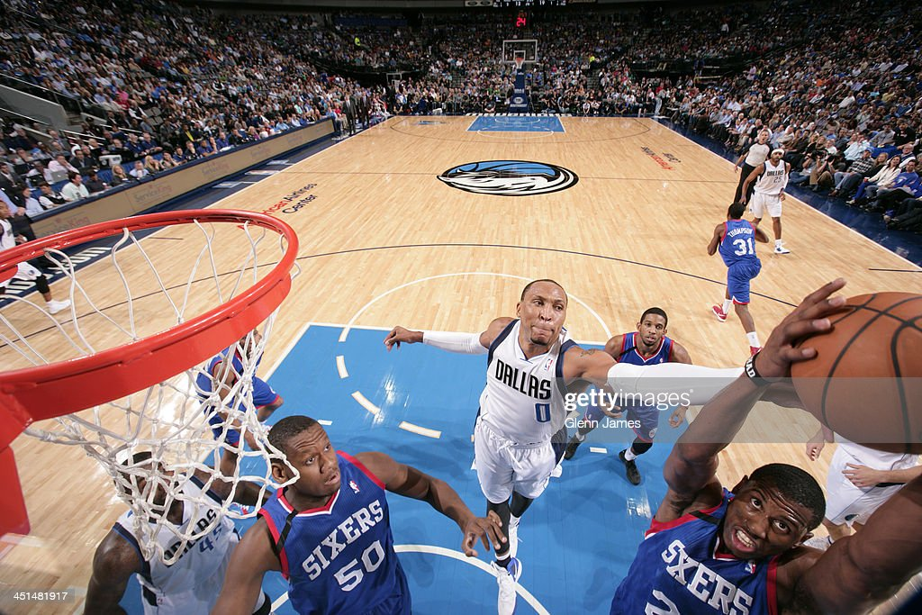 <a gi-track='captionPersonalityLinkClicked' href=/galleries/search?phrase=Shawn+Marion&family=editorial&specificpeople=201566 ng-click='$event.stopPropagation()'>Shawn Marion</a> #0 of the Dallas Mavericks grabs a rebound against <a gi-track='captionPersonalityLinkClicked' href=/galleries/search?phrase=Tim+Ohlbrecht&family=editorial&specificpeople=4337144 ng-click='$event.stopPropagation()'>Tim Ohlbrecht</a> #20 of the Philadelphia 76ers on November 18, 2013 at the American Airlines Center in Dallas, Texas.
