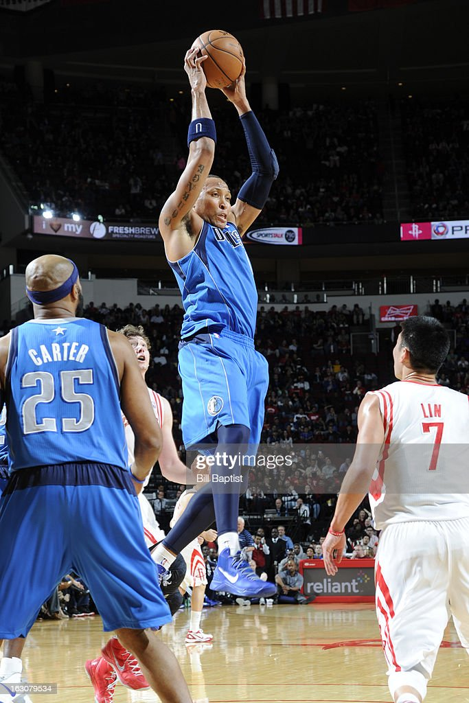 <a gi-track='captionPersonalityLinkClicked' href=/galleries/search?phrase=Shawn+Marion&family=editorial&specificpeople=201566 ng-click='$event.stopPropagation()'>Shawn Marion</a> #0 of the Dallas Mavericks grabs the rebound against the Houston Rockets on March 3, 2013 at the Toyota Center in Houston, Texas.