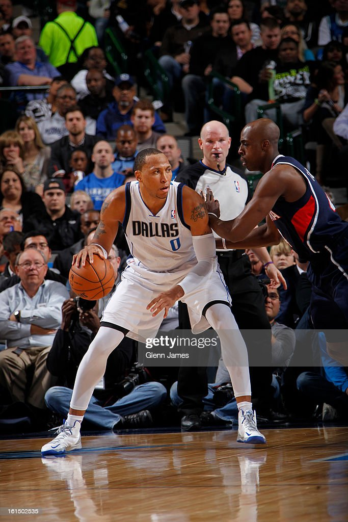 Shawn Marion #0 of the Dallas Mavericks posts up against Anthony Tolliver #4 of the Atlanta Hawks on February 11, 2013 at the American Airlines Center in Dallas, Texas.