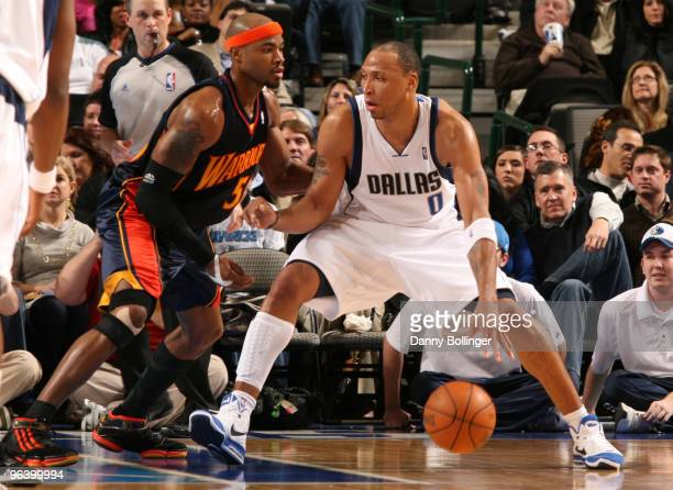 Shawn Marion of the Dallas Mavericks posts up against Corey Maggette of the Golden State Warriors during a game at the American Airlines Center on...