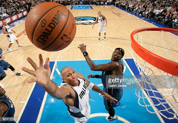 Shawn Marion of the Dallas Mavericks puts in a layup against Andray Blatche of the Washington Wizards during the season opener at the American...