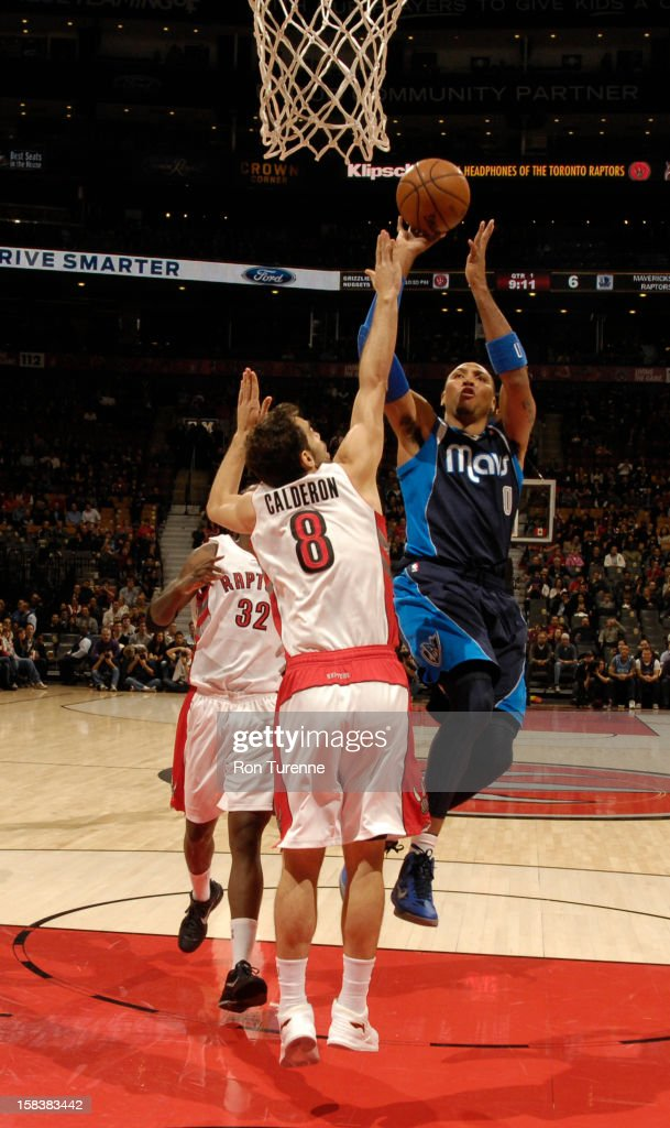 Shawn Marion #0 of the Dallas Mavericks puts up a shot over Jose Calderon #8 of the Toronto Raptors on December 14, 2012 at the Air Canada Centre in Toronto, Ontario, Canada.