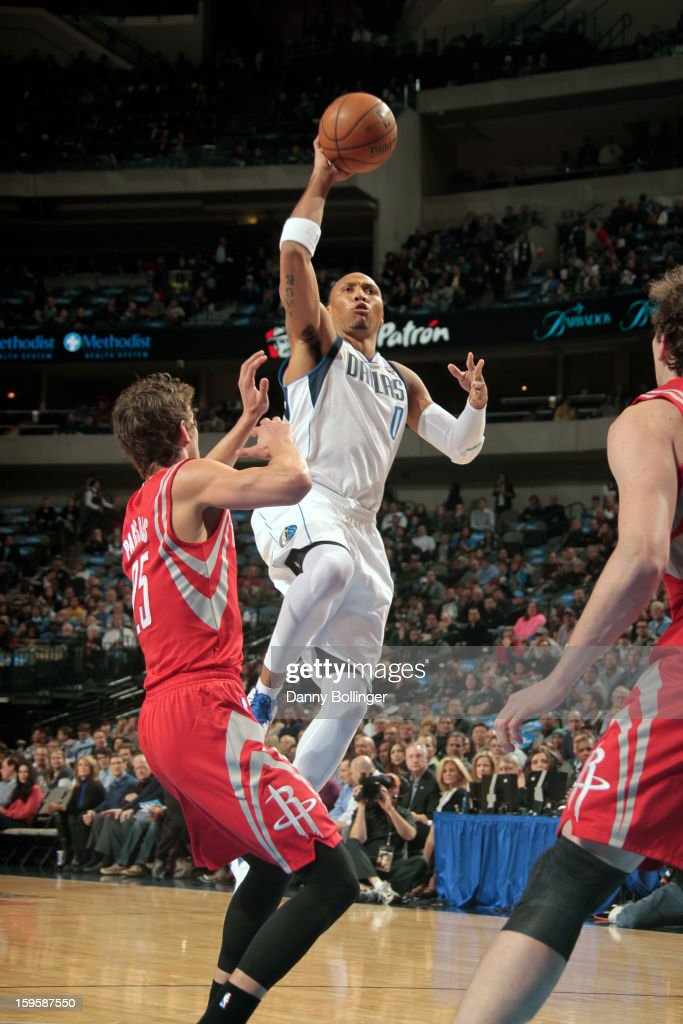 Shawn Marion #0 of the Dallas Mavericks puts up the floater against Chandler Parsons #25 of the Houston Rockets on January 16, 2013 at the American Airlines Center in Dallas, Texas.