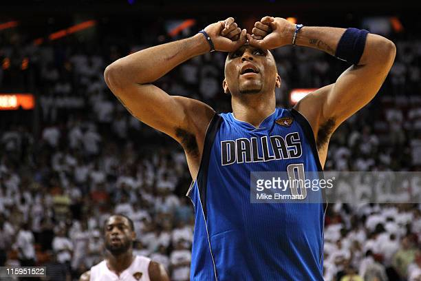 Shawn Marion of the Dallas Mavericks reacts as Dwyane Wade of the Miami Heat looks on in the background in Game Six of the 2011 NBA Finals at...