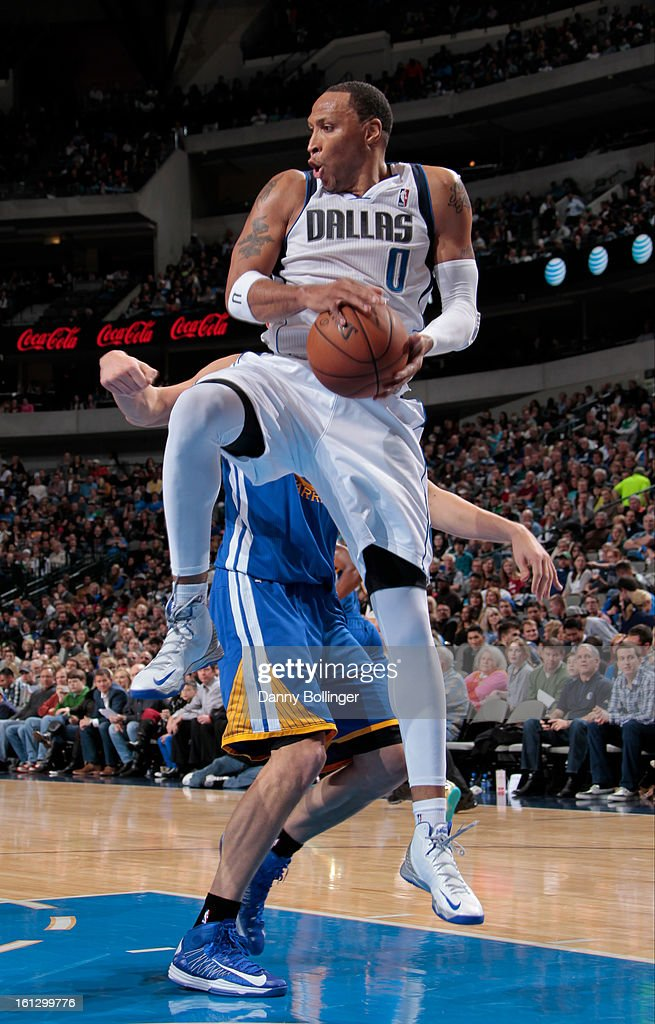 Shawn Marion #0 of the Dallas Mavericks rebounds against the Golden State Warriors on February 9, 2013 at the American Airlines Center in Dallas, Texas.