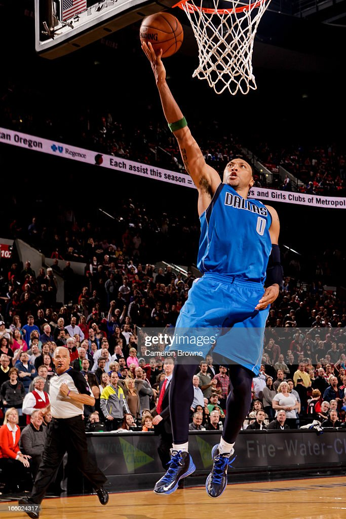 <a gi-track='captionPersonalityLinkClicked' href=/galleries/search?phrase=Shawn+Marion&family=editorial&specificpeople=201566 ng-click='$event.stopPropagation()'>Shawn Marion</a> #0 of the Dallas Mavericks shoots a layup on a fast break against the Portland Trail Blazers on April 7, 2013 at the Rose Garden Arena in Portland, Oregon.