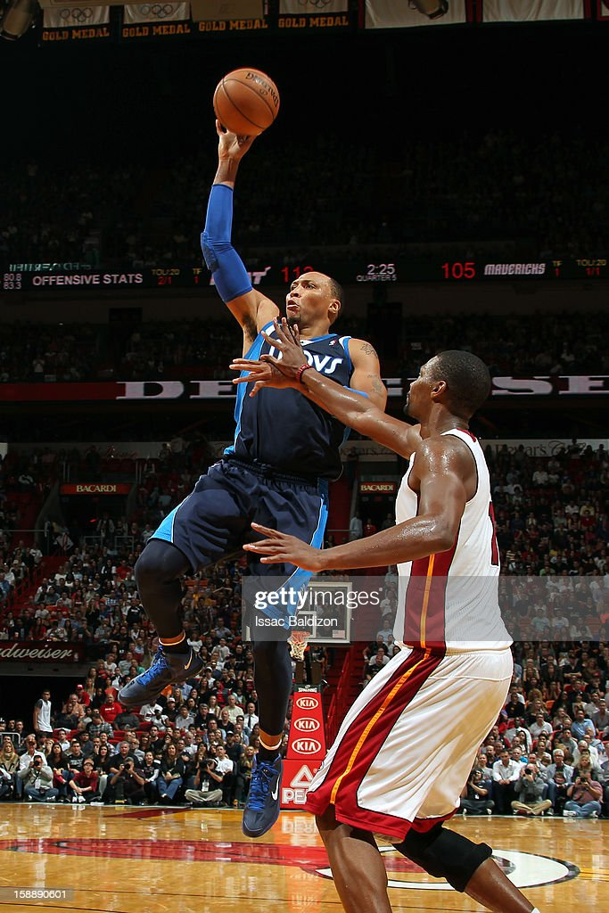 <a gi-track='captionPersonalityLinkClicked' href=/galleries/search?phrase=Shawn+Marion&family=editorial&specificpeople=201566 ng-click='$event.stopPropagation()'>Shawn Marion</a> #0 of the Dallas Mavericks shoots against the Miami Heat on January 2, 2013 at American Airlines Arena in Miami, Florida.
